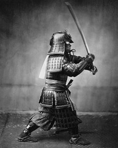 Samurai with sword, practicing a form of Japanese martial arts.