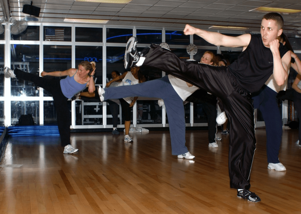 People in MMA classes training to kick box.