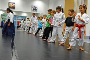 Kids within a martial arts classroom.